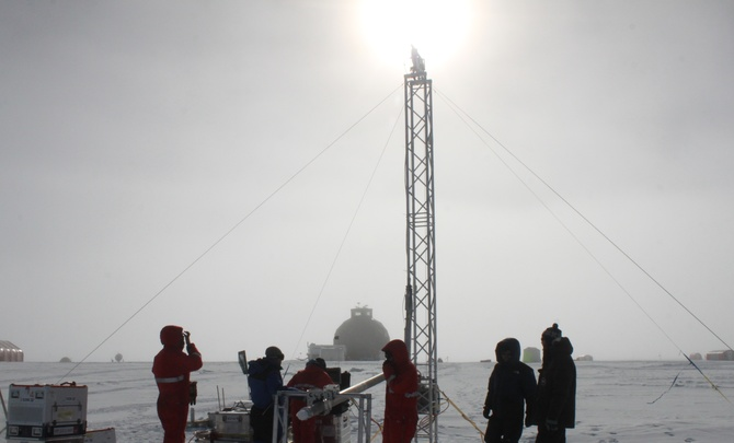 Ice core researchers drilling