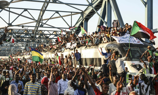Sudanese protesters crowd a train in the capital Khartoum.