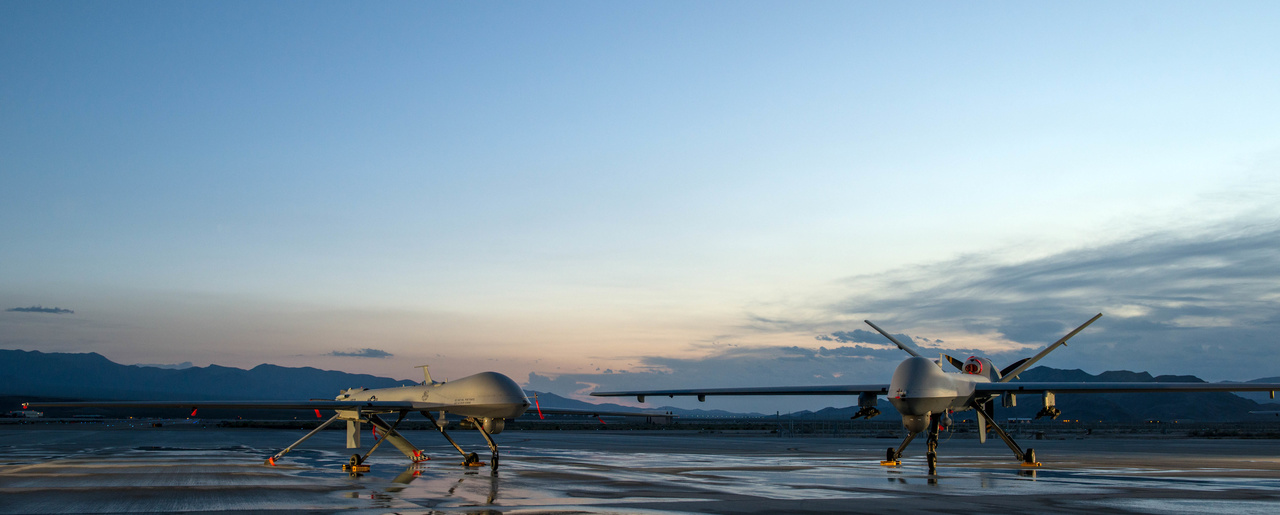 A MQ-1 Predator and a MQ-9 Reaper assigned to the 432nd Aircraft Maintenance Squadron remain ready for their next mission at Creech Air Force Base, Nevada, May 5, 2015.