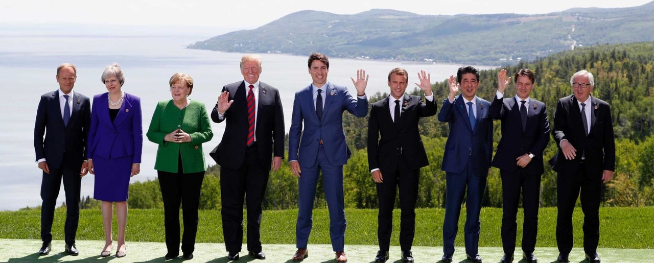From left to right: European Council President Donald Tusk, British Prime Minister Theresa May, German Chancellor Angela Merkel, U.S. President Donald Trump, Canadian Prime Minister Justin Trudeau, French President Emmanuel Macron, Japanese Prime Minister Shinzo Abe, Italian Prime Minister Giuseppe Conte, and European Commission President Jean-Claude Juncker