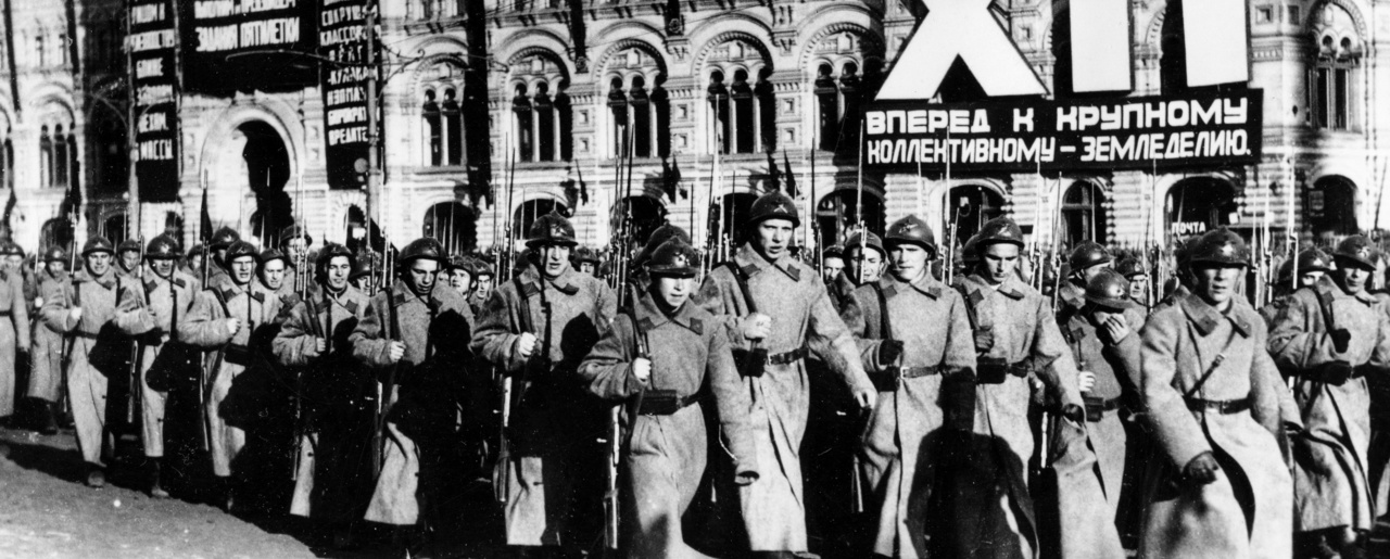 "Soldiers of the Soviet Red Army are marching in a parade at Moscow's Red Square, in this undated photograph. In the background the ""GUM,"" the largest department store in Moscow, is decorated with huge banners of government propaganda. (AP Photo)"