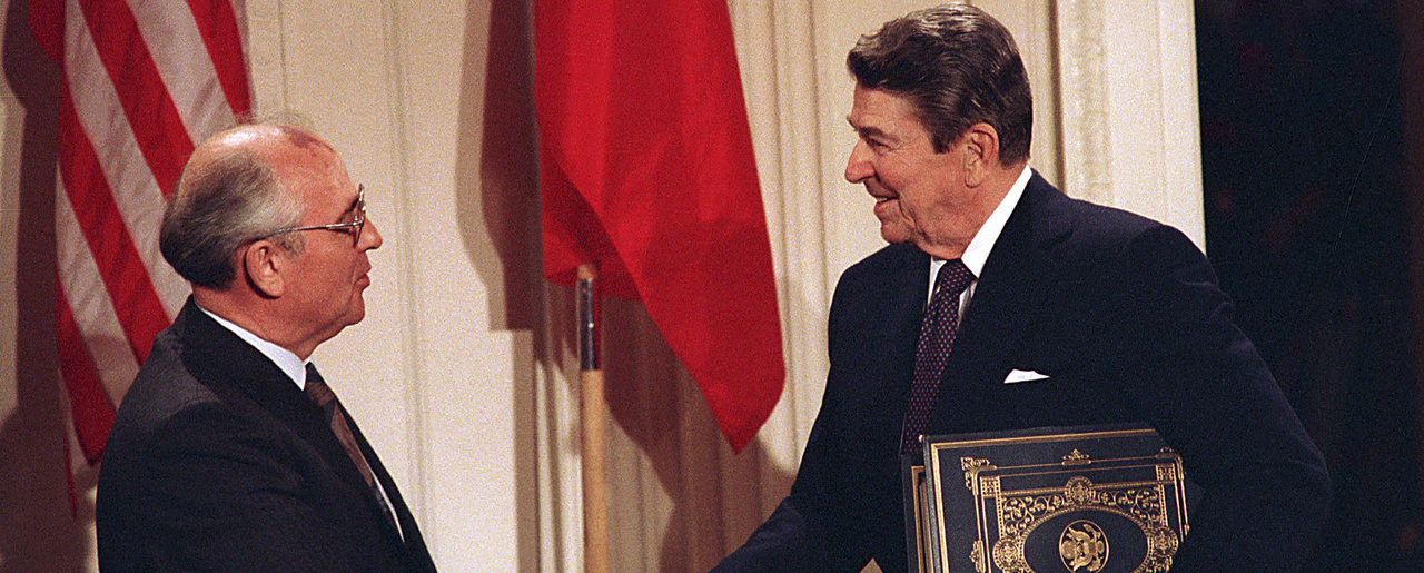 Soviet leader Mikhail Gorbachev and U.S. President Ronald Reagan shake hands after signing the INF treaty