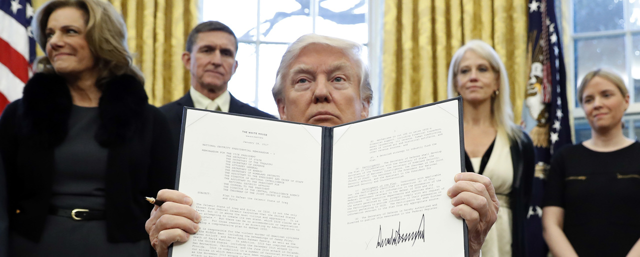 "In this Saturday, Jan. 28, 2017 file photo, President Donald Trump holds up a signed Presidential Memorandum in the Oval Office in Washington. Just two days after banning travelers from seven Muslim-majority nations, U.S. President Donald Trump invited the Saudi monarch, whose kingdom includes Islam's holiest sites, to fly to Washington. It points to the delicate balancing act Trump faces as he tries to deliver on campaign promises to exterminate ""radical Islamic terrorism"" without endangering political and"