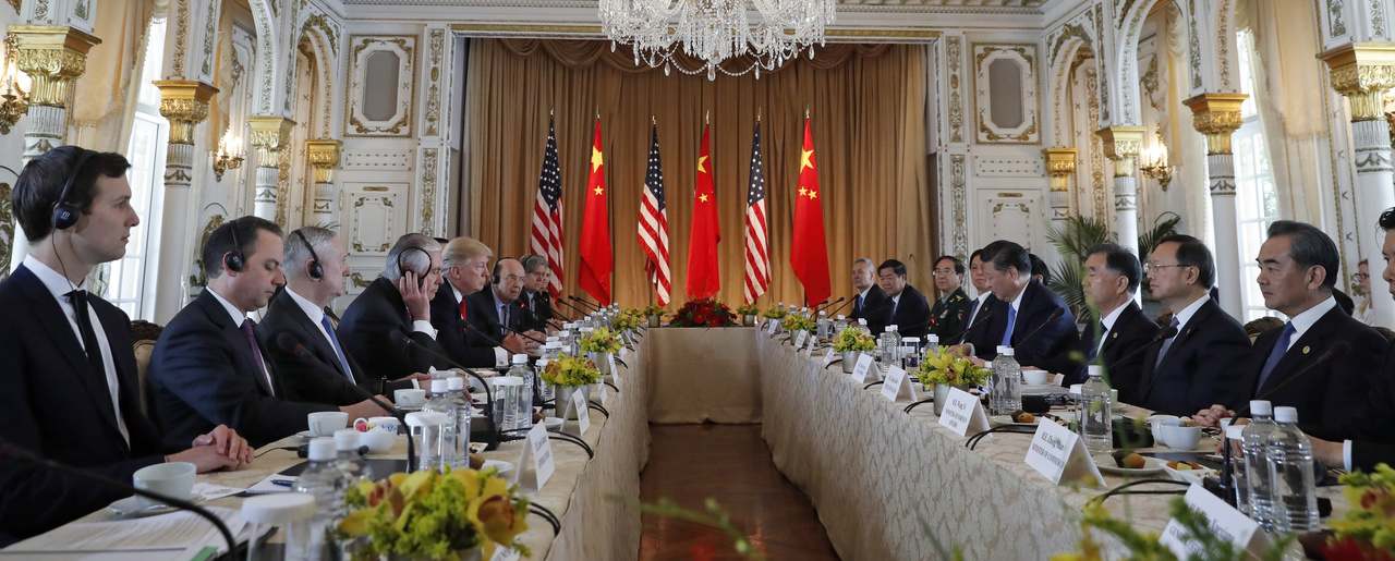 Photo of Presidents Trump and Xi around table at Mar-a-Lago April 2017.