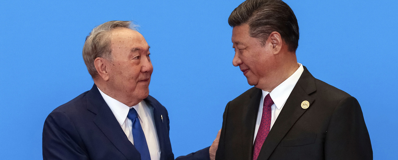 Chinese President Xi Jinping, right, shakes hands with Kazakhstan President Nursultan Nazarbayev during the welcome ceremony for the Belt and Road Forum, at the International Conference Center at Yanqi Lake in Beijing. May 15, 2017 (Roman Pilipey/Pool Photo via Associated Press).