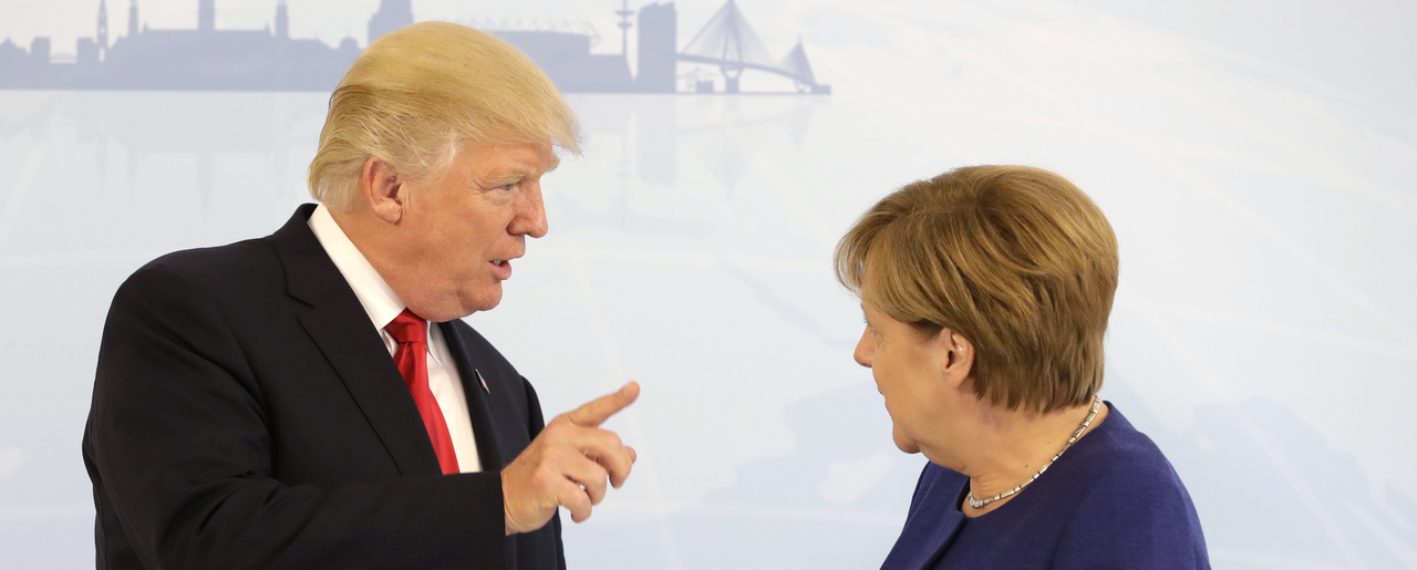 U.S. President Donald Trump, left, and German Chancellor Angela Merkel at a bilateral meeting on the eve of the G-20 summit in Hamburg, Germany, on July 6, 2017 (AP Photo/Matthias Schrader, pool).