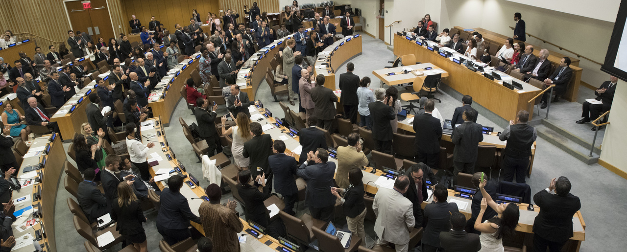 Delegates at the United Nations give a standing ovation after a vote to adopt the Treaty on the Prohibition of Nuclear Weapons on July 7, 2017 (Mary Altaffer/Associated Press).