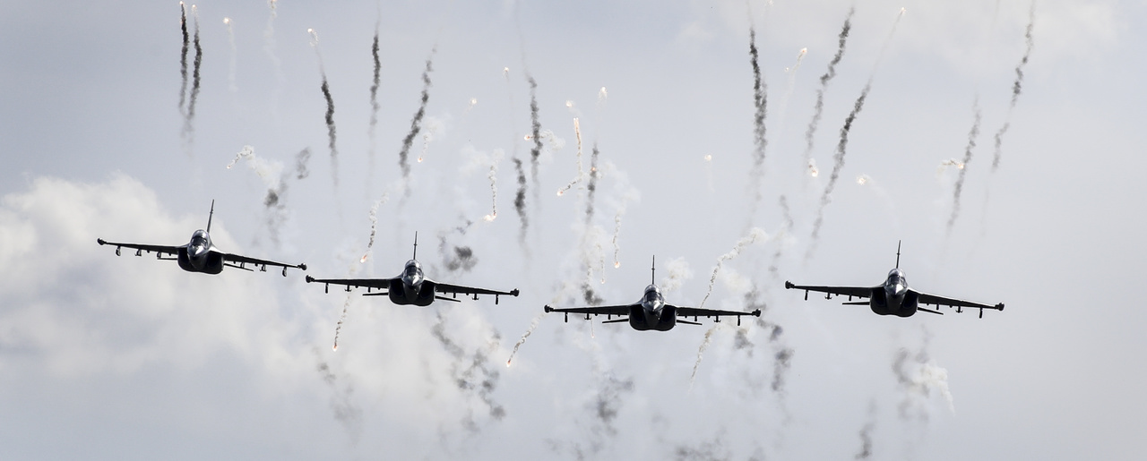 Belarusian military jets fly during military exercises, Belarus, Tuesday, Sept. 19, 2017. The Zapad (West) 2017 military drills held jointly by Russian and Belarusian militaries at several firing ranges in both countries have rattled Russia's neighbors. (AP Photo/Sergei Grits, Pool)