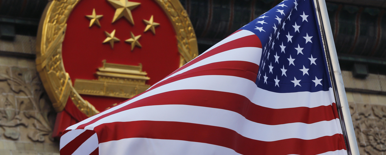 The American flag flies alongside a Chinese national symbol as President Donald Trump is welcomed to a summit in Beijing, November 9, 2017.
