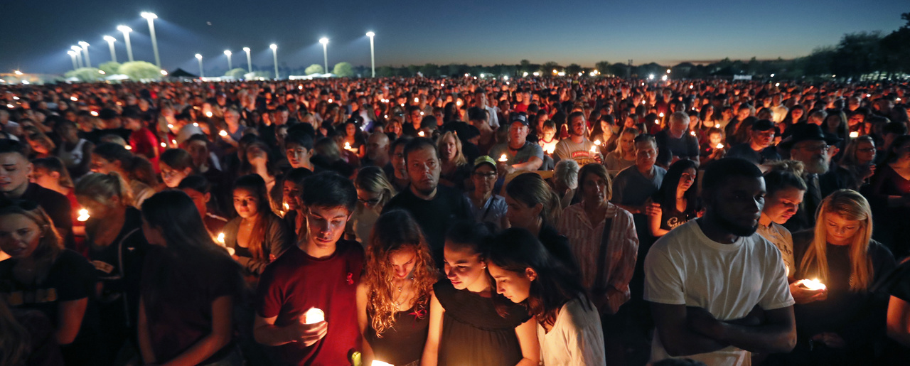 People attend a candlelight vigil for the victims of the shooting at Marjory Stoneman Douglas High School, in Parkland, Fla. February 15, 2018 (Gerald Herbert/Associated Press). Keywords: Parkland, school shooting