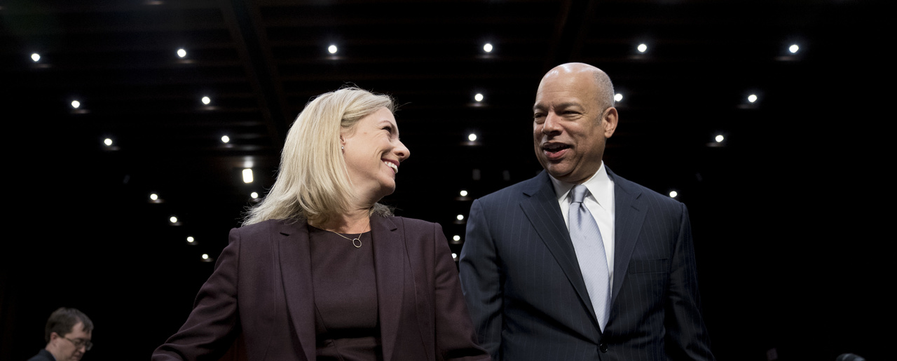 Former Homeland Security Secretary Jeh Johnson, right, and Homeland Security Secretary Kirstjen Nielsen, and former arrive for a Senate Intelligence Committee hearing in Washington on Wednesday, March 21, 2018. (AP Photo/Andrew Harnik)