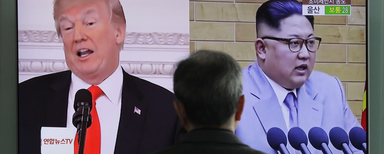 A man watches a TV screen showing file images of U.S. President Donald Trump, left, and North Korean leader Kim Jong Un, right, during a news program at the Seoul Railway Station in Seoul, South Korea. March 27, 2018 (Lee Jin-man/Associated Press). Keywords: Donald Trump, Kim Jong-Un, nuclear