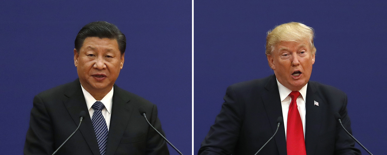 In this combination of photos, U.S. President Donald Trump, right, and Chinese President Xi Jinping speak during a business event at the Great Hall of the People in Beijing on Nov. 9, 2017. (AP Photo/Andy Wong)