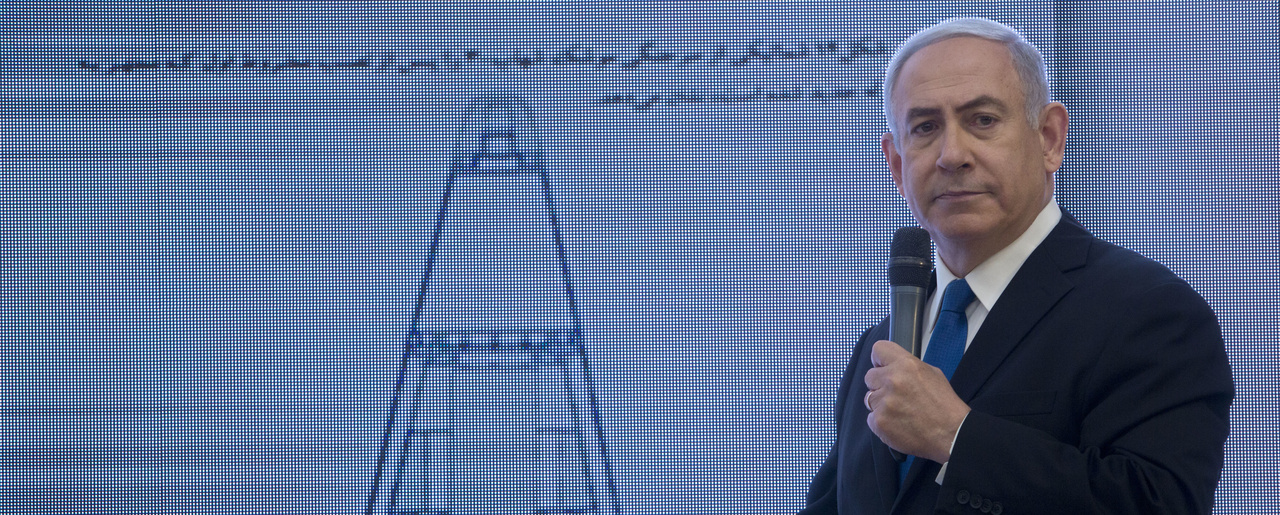 Israeli Prime Minister Benjamin Netanyahu presents material on Iranian nuclear weapons development during a press conference in Tel Aviv. April 30, 2018 (Sebastian Scheiner/Associated Press).