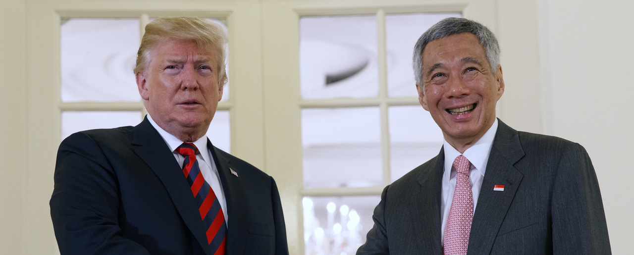 President Donald Trump shakes hands as he meets with Singapore Prime Minister Lee Hsien Loong on Monday, June 11, 2018, in Singapore. Trump is scheduled to attend a summit with North Korean leader Kim Jong Un on June 12, 2018. (AP Photo/Evan Vucci)