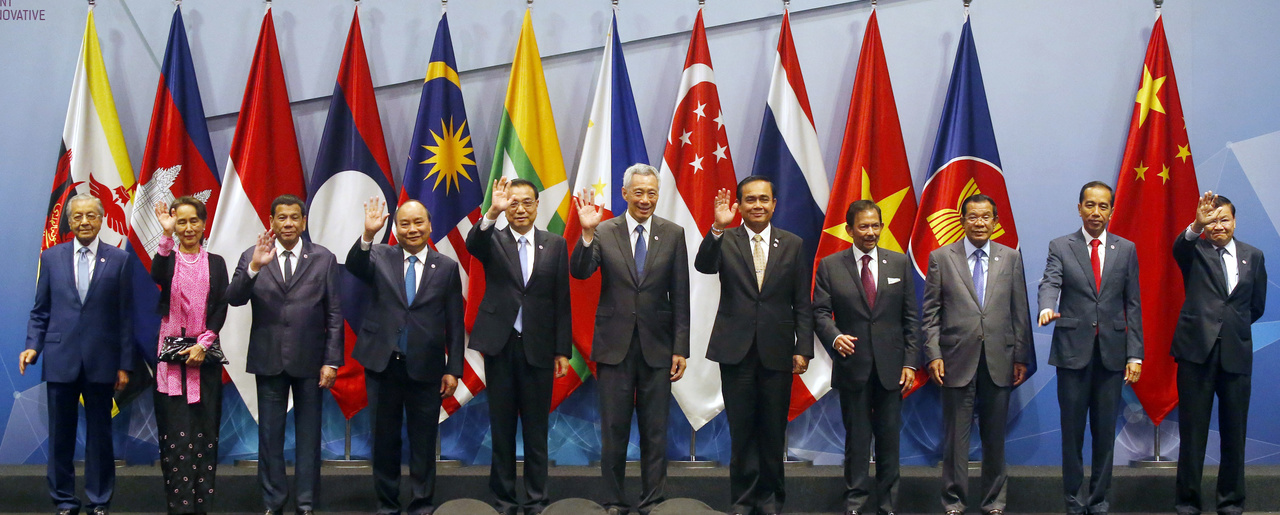 Chinese Premier Li Keqiang, fifth from left, poses for a group photo with ASEAN Leaders prior to the start of the ASEAN Plus China Summit in the ongoing ASEAN Summit and Related Summits on November 14, 2018 in Singapore.