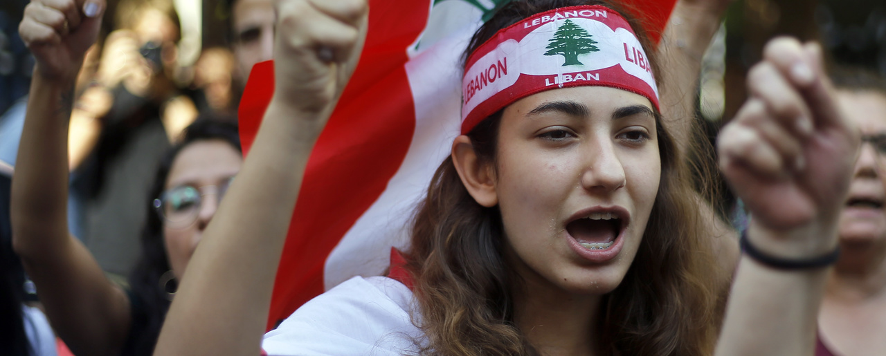 Protester chant slogans during ongoing protests against the Lebanese government, in front of the central bank, in Beirut, Lebanon, Monday, Oct. 28, 2019. The protests have paralyzed the country but have been largely peaceful.