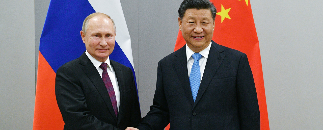 Russian President Vladimir Putin, left, and China's President Xi Jinping shake hands prior to their talks on the sideline of the 11th edition of the BRICS Summit, in Brasilia, Brazil, Wednesday, Nov. 13, 2019.