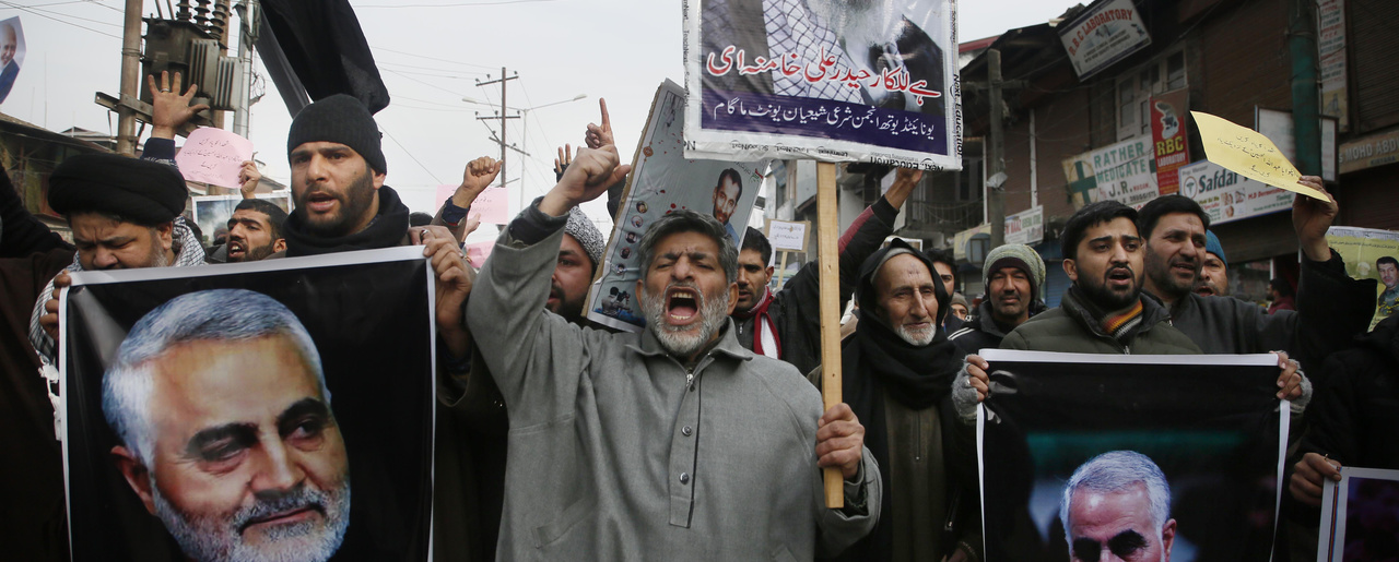 Kashmiri Shiite Muslims shout anti American and anti Israel slogans during a protest against U.S. airstrike in Iraq that killed Iranian Revolutionary Guard Gen. Qassem Soleimani, seen in the photographs, at Magam 37 kilometers (23 miles) north of Srinagar, Indian controlled Kashmir, Friday, Jan. 3, 2020