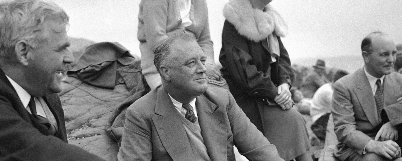 President Franklin D. Roosevelt in 1936 at Campobello Island in Maine, where he often spent summers. When the United Kingdom was running short on supplies and money in its fight against Nazi Germany in 1940, Roosevelt spent ten days away from the White House on a Navy ship, reemerging with the idea for the Lend-Lease Act (AP Photo).