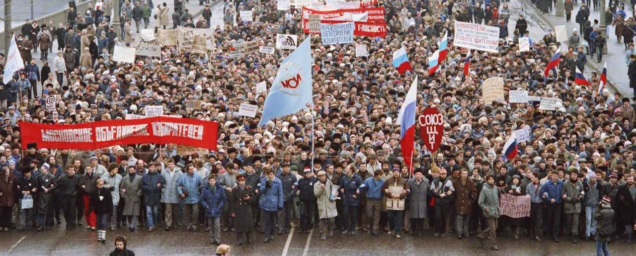 Collapse of Soviet Union Pro-democracy demonstrators file across Moscow's Crimean Bridge to link up with thousands more converging on a square in the downtown area in Moscow, Feb. 23, 1990. Those in the foreground wave flags and banners of one of the organization seeking free elections throughout the Soviet Union. (AP Photo/Boris Yurchenko)