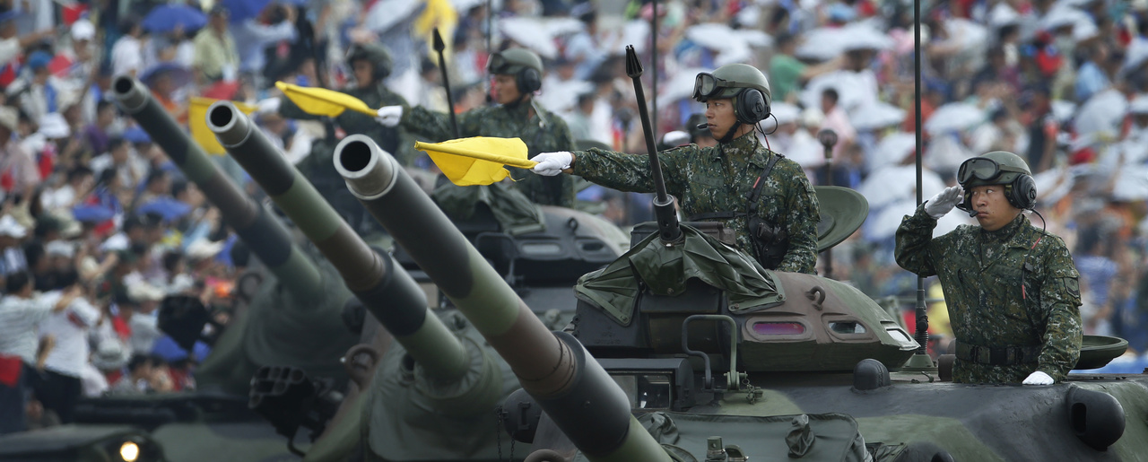 Taiwan's military displays tanks in a parade in Hsinchu, northern Taiwan, Saturday, July 4, 2015.