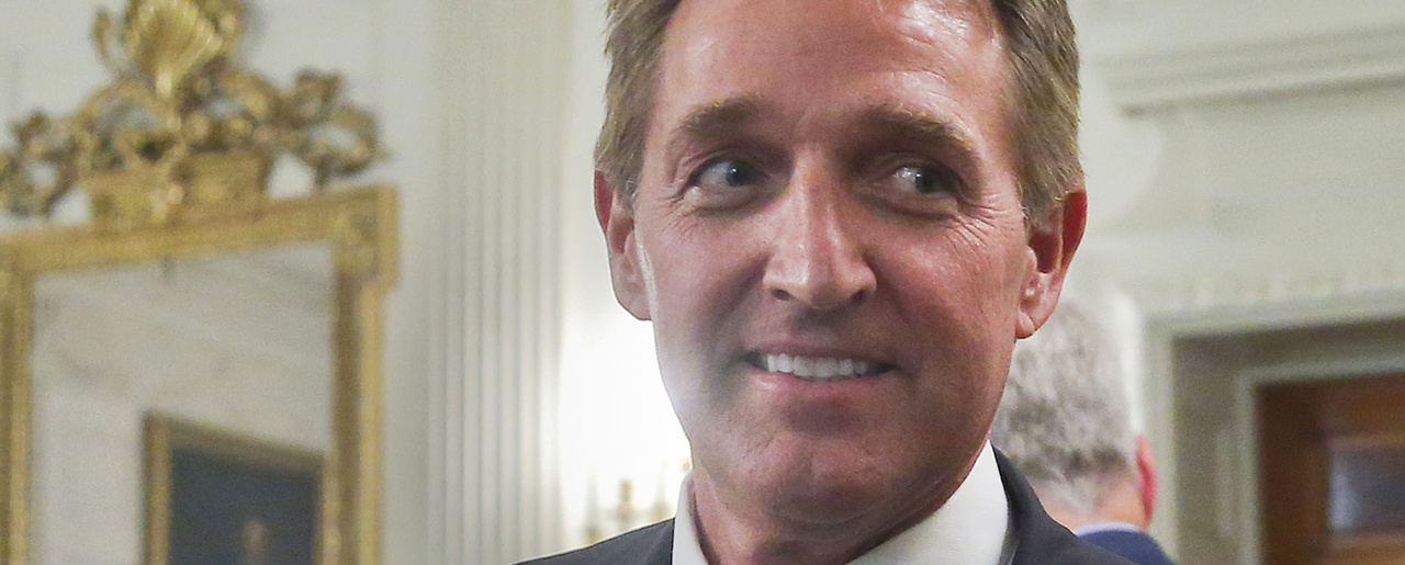 In this photo taken July 19, 2017, Sen. Jeff Flake, R-Ariz. walks to his seat as he attends a luncheon with other GOP Senators and President Donald Trump at the White House in Washington. (AP Photo/Pablo Martinez Monsivais)
