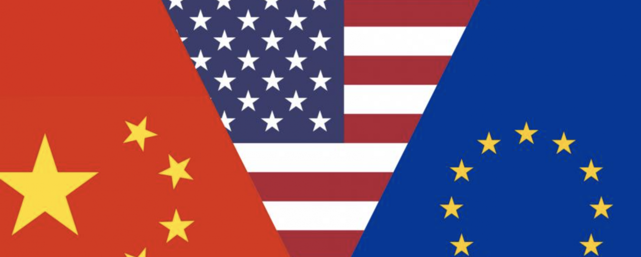 (Left-to-right) The Chinese, US, and EU flags overlapping