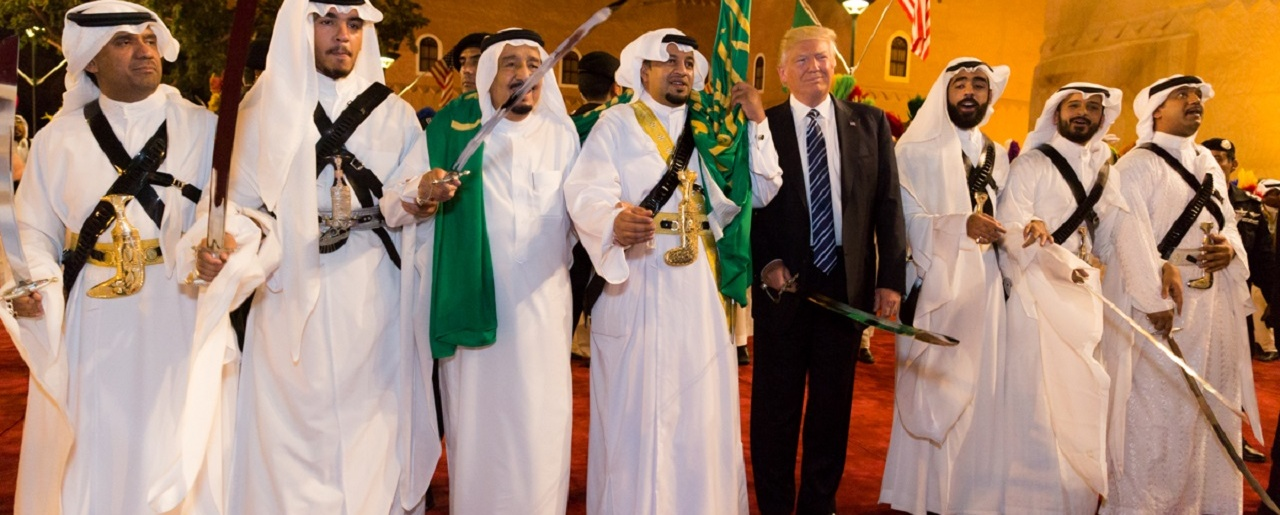 President Donald Trump poses for photos with ceremonial swordsmen on his arrival to Murabba Palace, as the guest of King Salman bin Abdulaziz Al Saud of Saudi Arabia, Saturday evening, May 20, 2017, in Riyadh, Saudi Arabia.