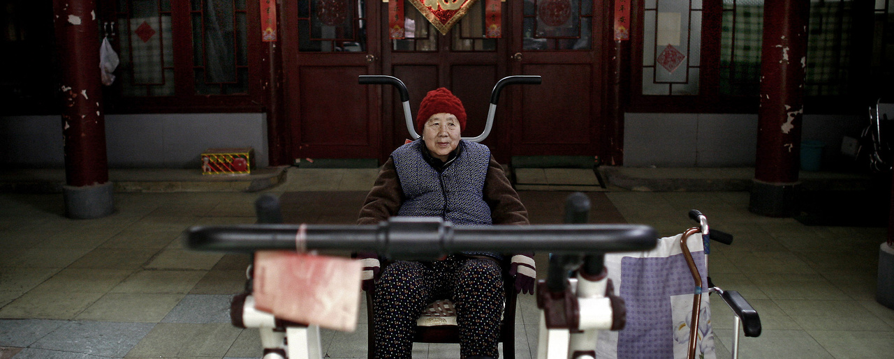 An elderly woman exercises