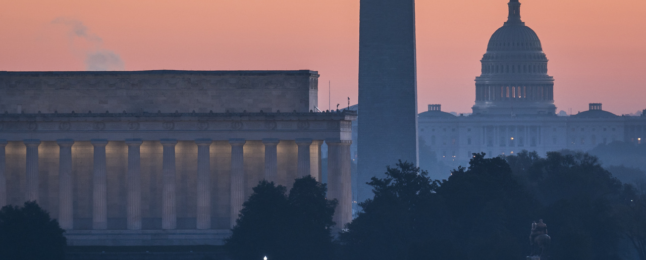 skyline is seen at dawn in Washington, D.C.