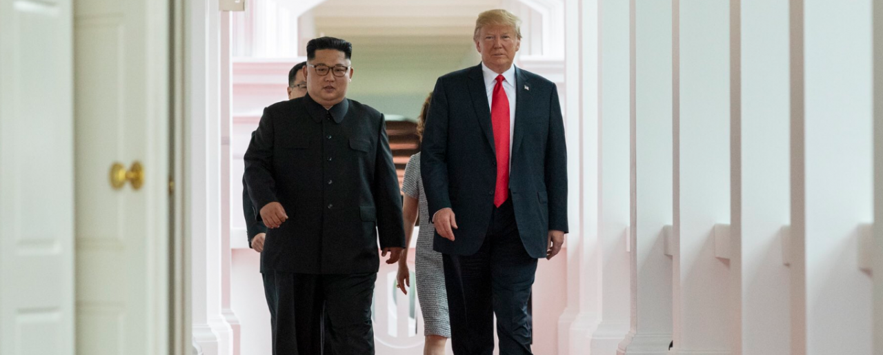 Kim and Trump walking to the summit room