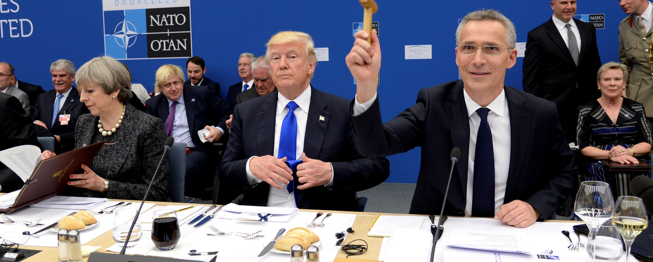 NATO Secretary General Jens Stoltenberg as U.S. President Donald Trump looks on, as they sit for a working dinner meeting