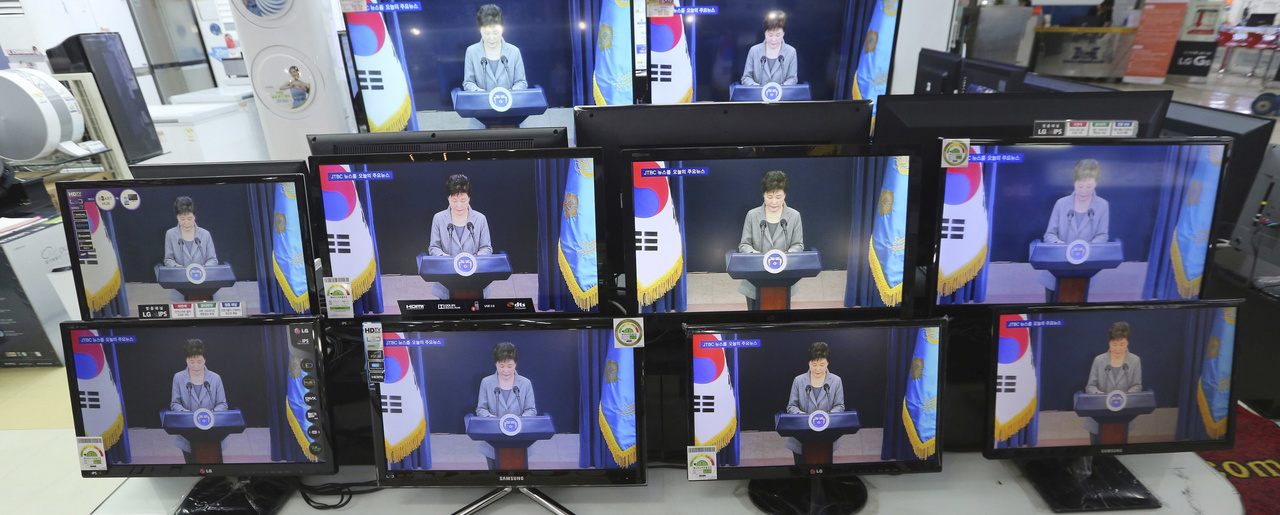 TV screens show file images of South Korean President Park Geun-hye in Seoul