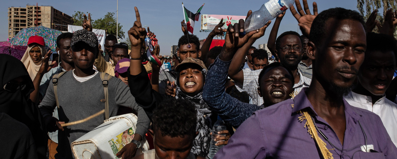 demonstraters rally near the military headquarters in Khartoum, Sudan