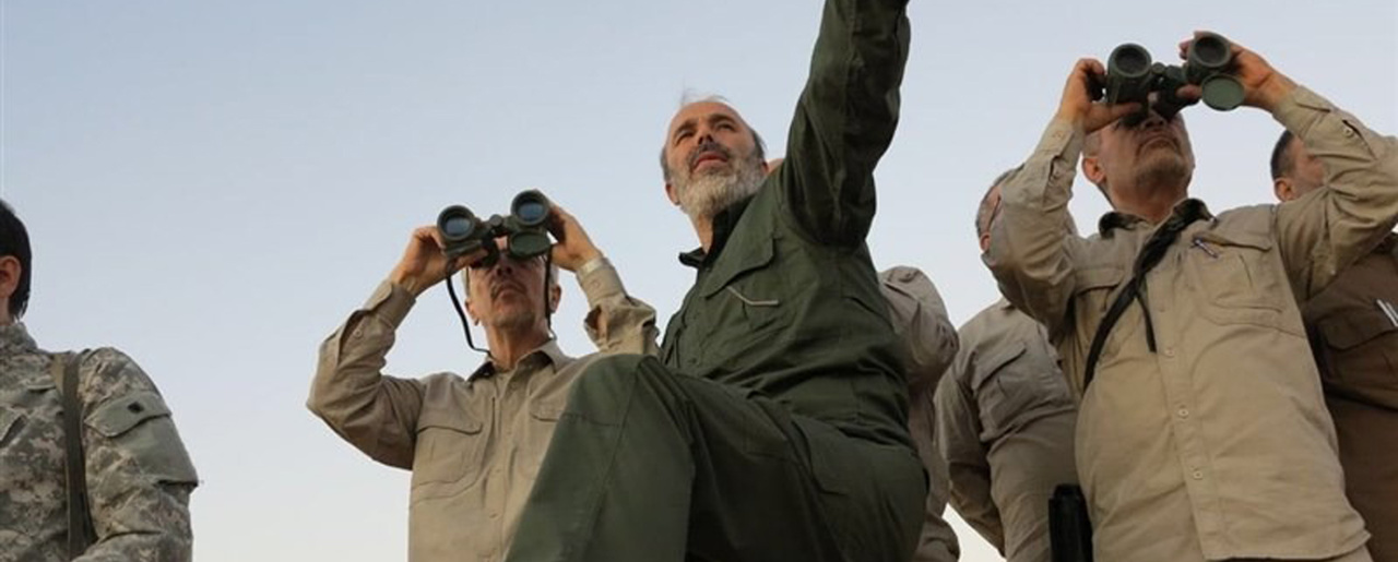 Maj. Gen. Mohammad Bagheri, left looking into binoculars, and other senior officers from the Iranian military