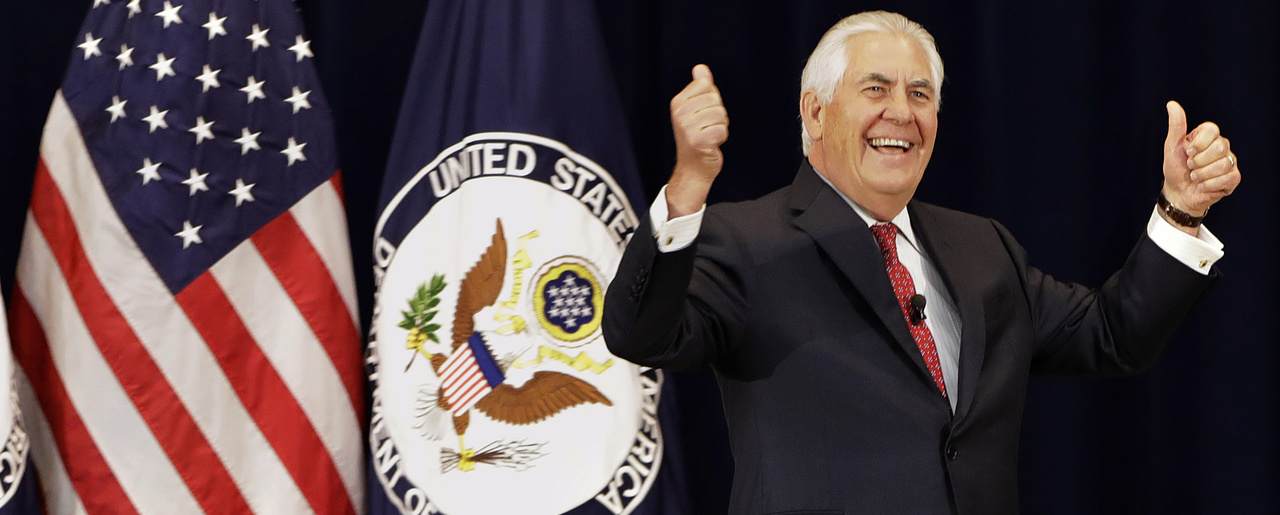Secretary of State Rex Tillerson gives a double thumbs-up as he arrives to speak to State Department employees