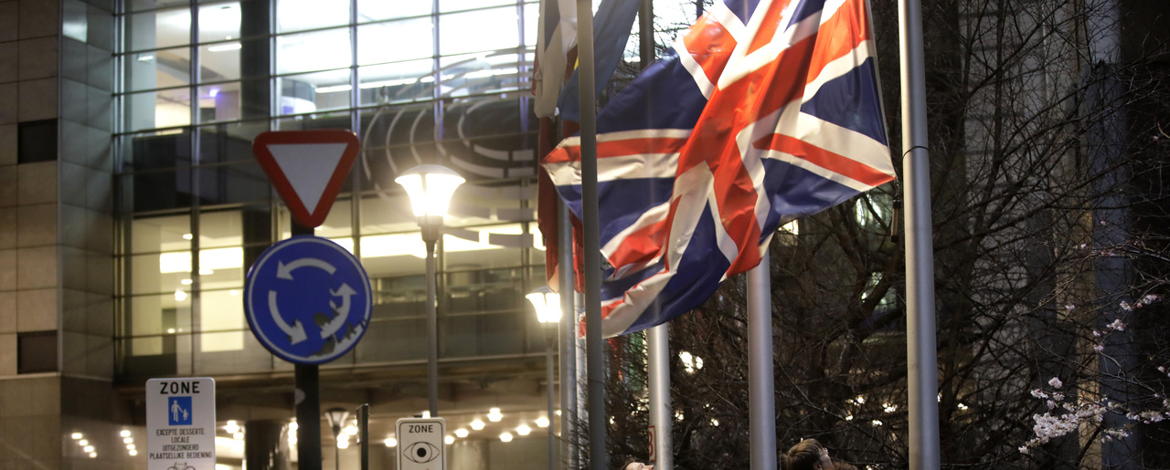 The Union Jack flag is lowered and removed from outside of the European Parliament