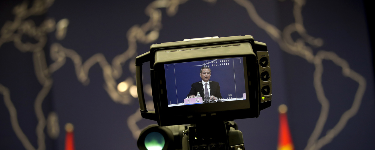 a camera monitor shows Chinese State Councilor and Foreign Minister Wang Yi speaking