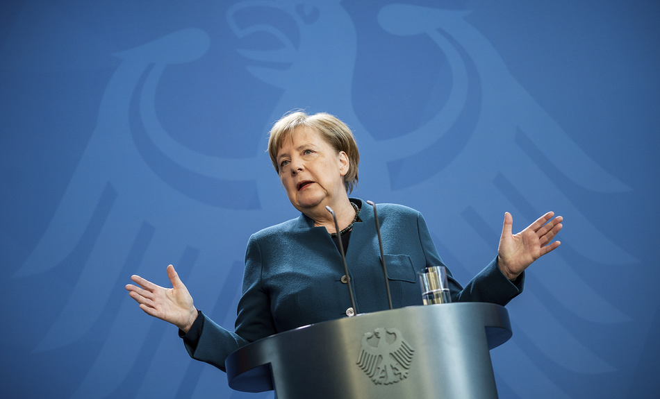 German Chancellor Angela Merkel speaks at a press conference about coronavirus, in Berlin, Sunday, March 22, 2020.