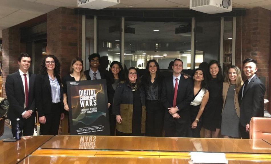 "Members of the Belfer Center's Economic Diplomacy Initiative gather after hosting ""Digital Currency Wars,"" a simulation of a live White House National Security Council meeting in response to a major security crisis."