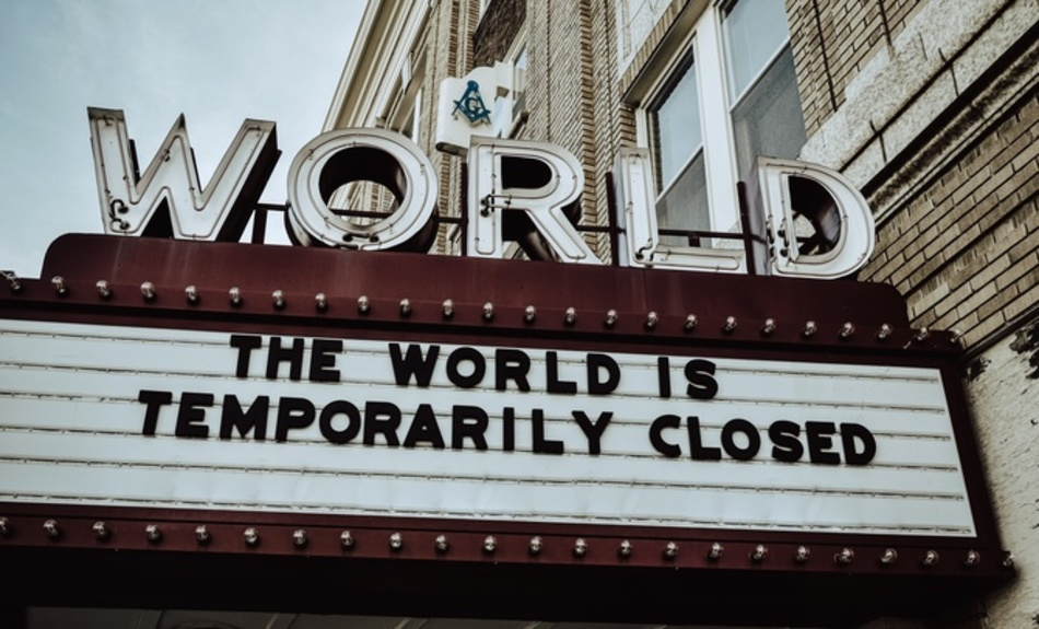 "The World Theater's marquee sign reads ""The World Is Temporarily Closed"""