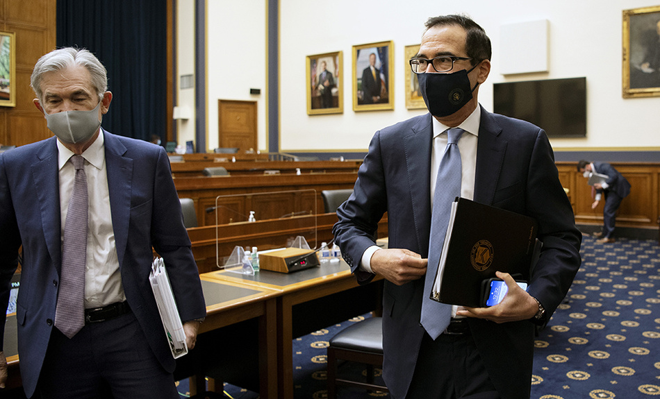 Federal Reserve Chair Jerome Powell, left, and Treasury Secretary Steve Mnuchin leave after a House Financial Services Committee hearing about the government's emergency aid to the economy in response to the coronavirus on Capitol Hill in Washington on Tuesday, Sept. 22, 2020.