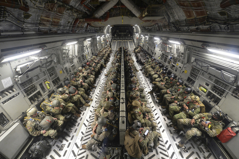 Special Operations Forces from the U.S., Republic of Korea, India, Indonesia, Peru, Philippines and Japan conduct an airborne insertion during Rim of the Pacific (RIMPAC) exercise from a U.S. Air Force Boeing C-17 Globemaster III, July 18, 2018. (U.S. Navy / Mass Communication Specialist 1st Class Cory Asato)