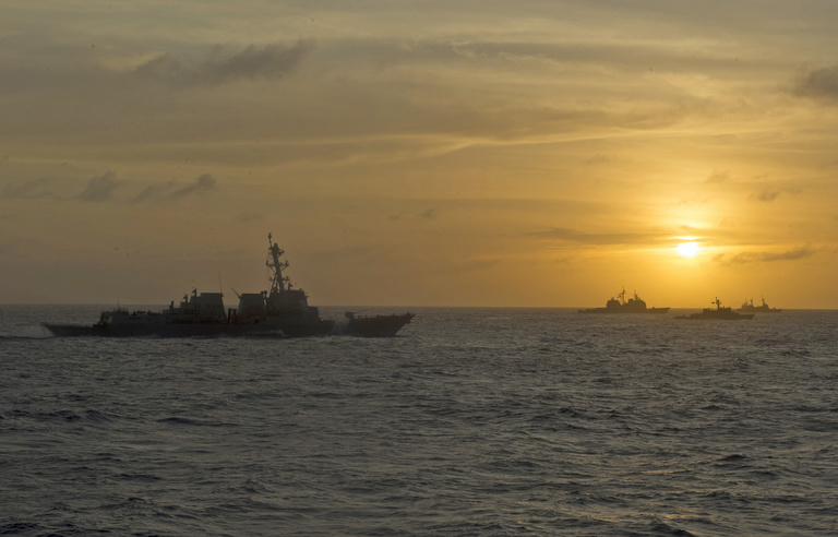 Multinational ships (left to right) guided-missile destroyer USS William P. Lawrence, guided-missile cruiser USS Lake Erie, Peruvian Navy maritime patrol boat BAP Ferré and Philippine Navy frigate BRP Andrés Bonifacio sail in formation at sunset during RIMPAC 2018.  (U.S. Coast Guard photo / Petty Officer 2nd Class David Weydert)