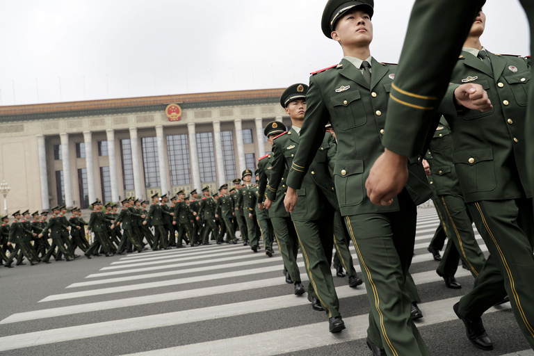 Chinese paramilitary policemen march outside the Great Hall of the People after attending a ceremony to commemorate the 90th anniversary of the founding of the People's Liberation Army in Beijing, Tuesday, Aug. 1, 2017. (AP Photo/Andy Wong)