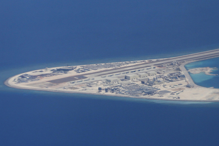 An airstrip, structures, and buildings on China's man-made Subi Reef in the Spratly chain of islands in the South China Sea are seen from a C-130 transport plane of the Philippine Air Force, April 21, 2017. (AP Photo/Bullit Marquez)