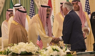 Secretary Tillerson and King Salman shake hands