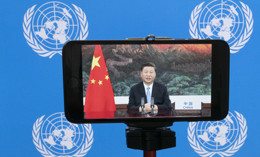 Chinese President Xi Jinping is seen on a phone screen remotely addressing the 75th session of the United Nations General Assembly, Tuesday, Sept. 22, 2020, at U.N. headquarters.