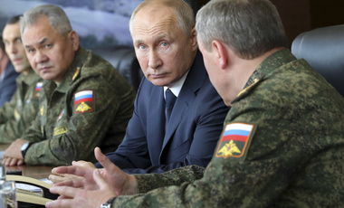 Russian President Vladimir Putin, center, and Russian Defense Minister Sergei Shoigu, left, attend the main stage of the Kavkaz-2020 strategic command-and-staff exercises at the Kapustin Yar training ground, Russia, Friday, Sept. 25, 2020.